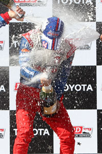 Champagne Spray on Takuma Sato