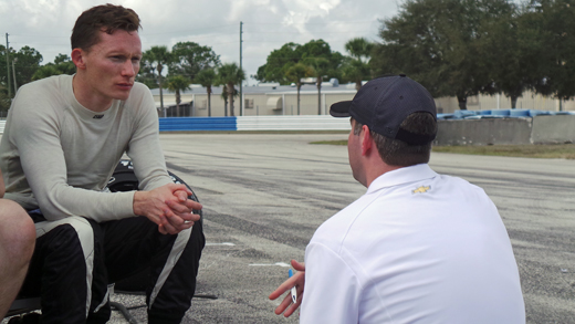 Mike Conway chats with a Chevy engineer at Sebring.