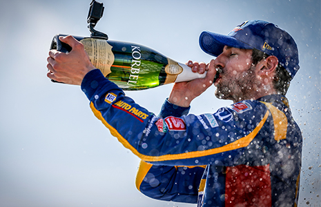 Alexander Rossi drinks champagne