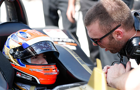 James Hinchcliffe in car talking with crewman