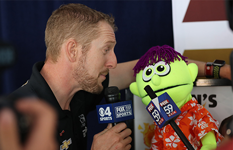 Charlie Kimball talks to puppet
