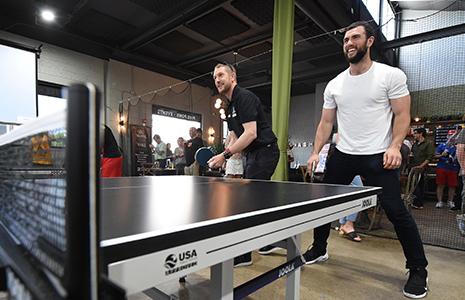Charlie Kimball and Andrew Luck playing ping pong