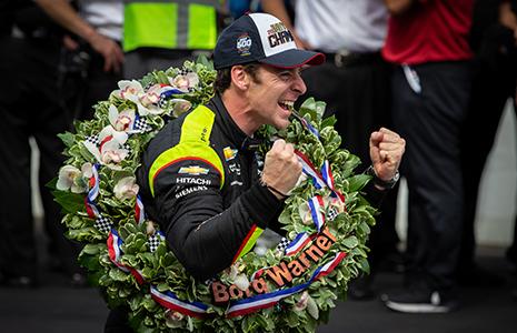 Simon Pagenaud wearing Indy 500 winner's wreath