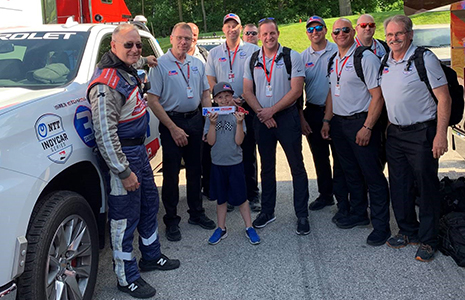 Teddy Madgwick with AMR INDYCAR Safety Team