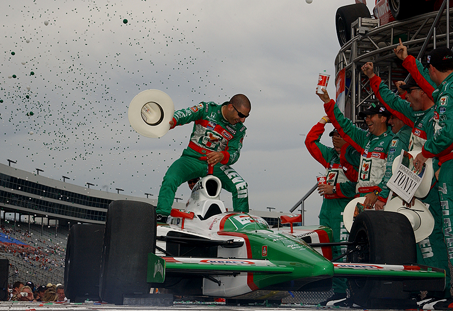 Tony Kanaan celebrates his 2004 NTT IndyCar Series title in Texas-style.