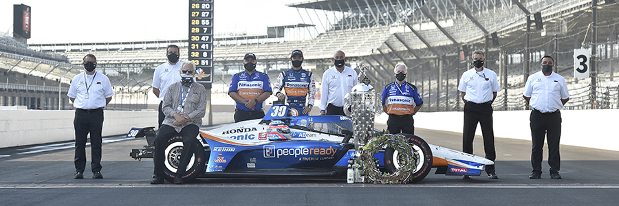 Takuma Sato with key team members