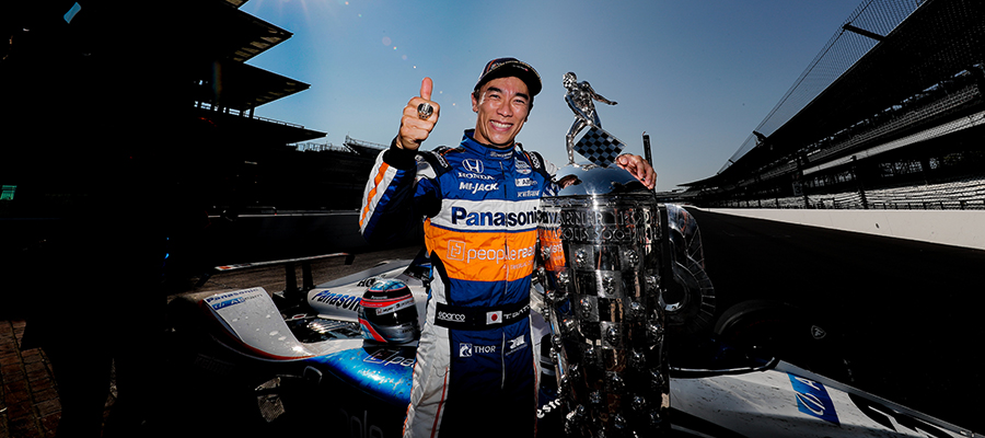 Takuma Sato with the Borg-Warner Trophy