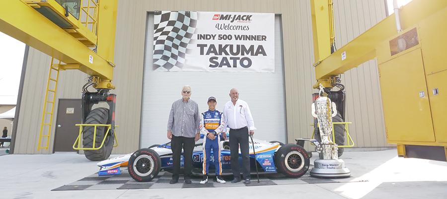 Takuma Sato, Mike Lanigan and Bobby Rahal at Mi-Jack headquarters