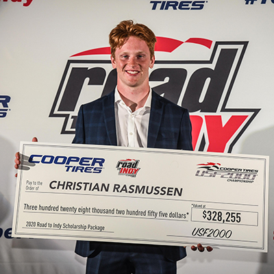 Christian Rasmussen and his champion's scholarship check.