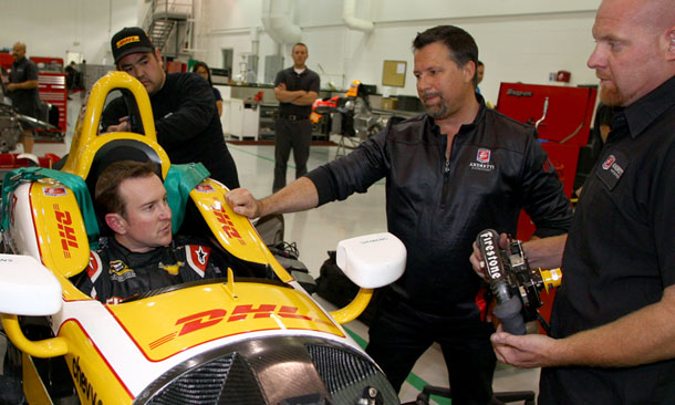 Kurt Busch with Michael Andretti during seat fit