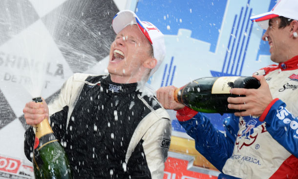 Mike Conway celebrates with Justin Wilson