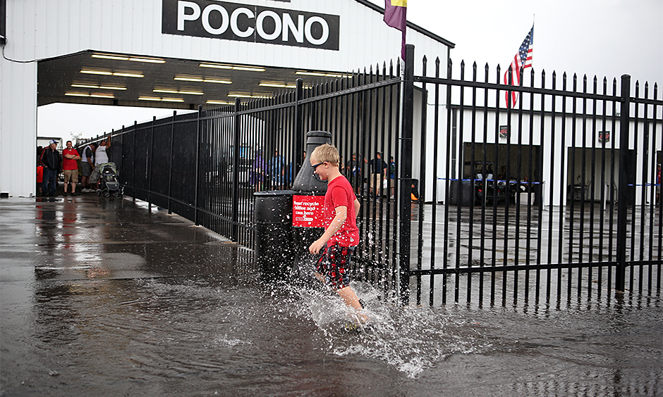Pocono fan splashes puddle