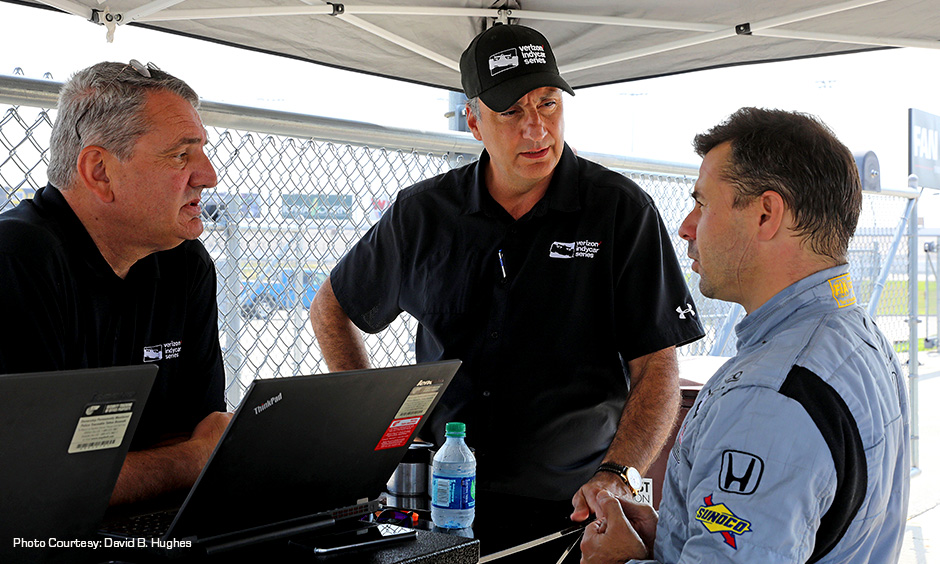 Test driver Oriol Servia with INDYCAR officials Tino Belli and Bill Pappas