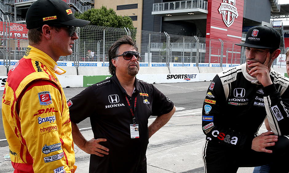 Team owner Michael Andretti talks with Ryan Hunter-Reay and Alexander Rossi.