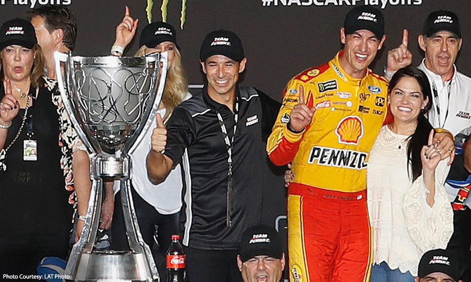 Helio Castroneves and Joey Logano celebrate after Team Penske secured the NASCAR Cup Championship.