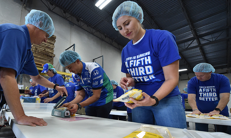 Graham Rahal and Courtney Force pack meals