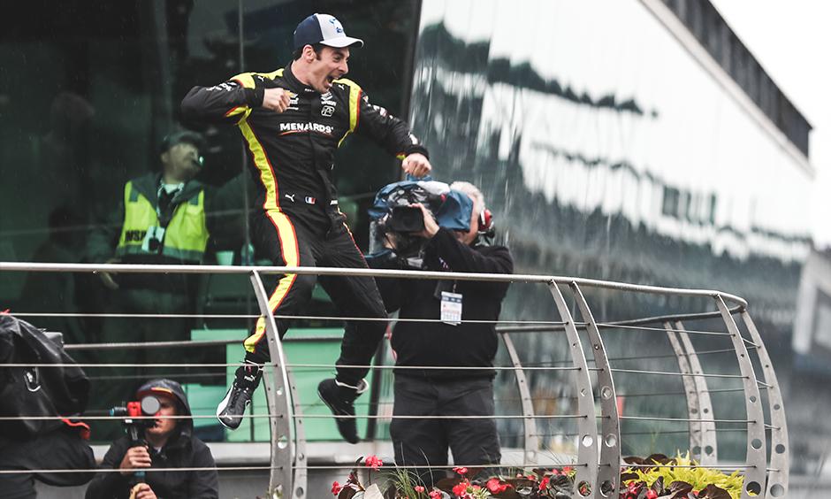 Simon Pagenaud leaps on INDYCAR Grand Prix podium