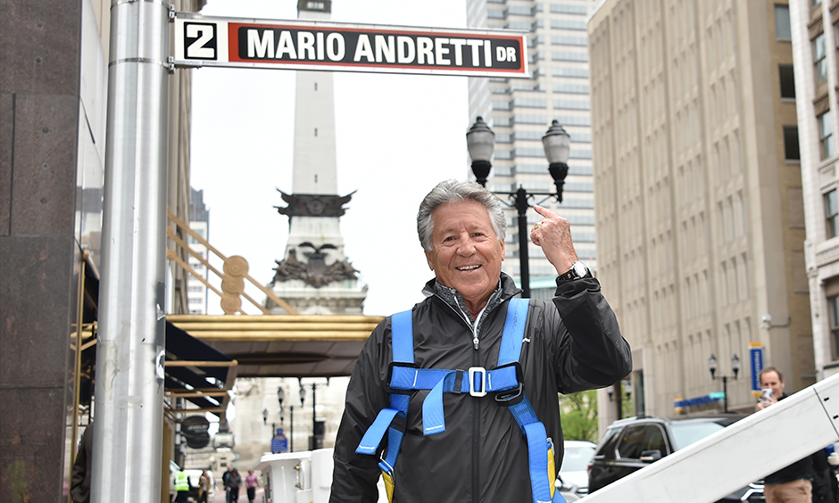 Mario Andretti with street sign