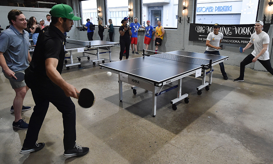 Kyle Kaiser, Helio Castroneves and Josef Newgarden playing ping poing
