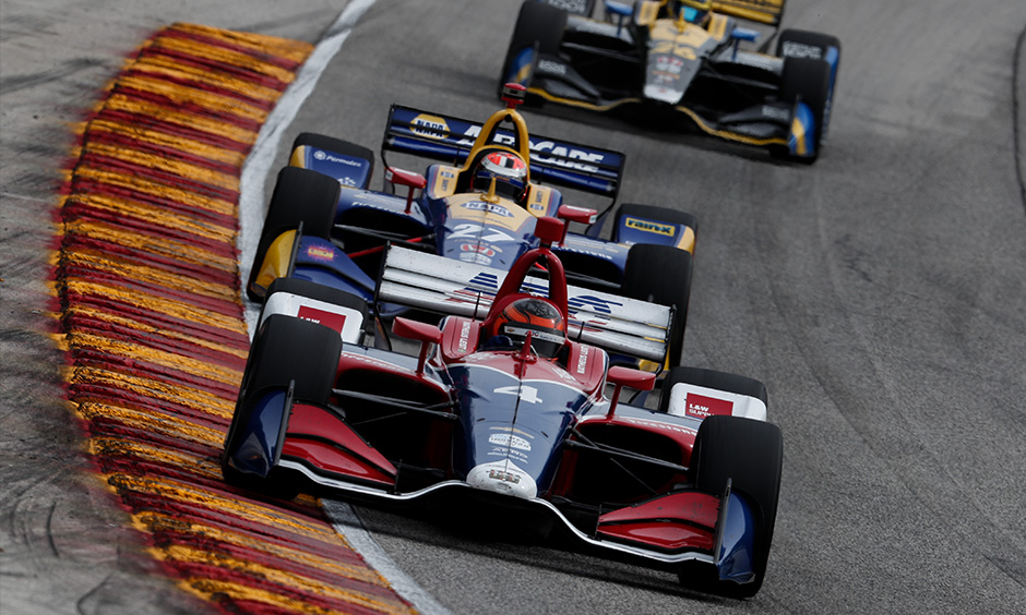 Matheus Leist, Alexander Rossi and Zach Veach on track Road America
