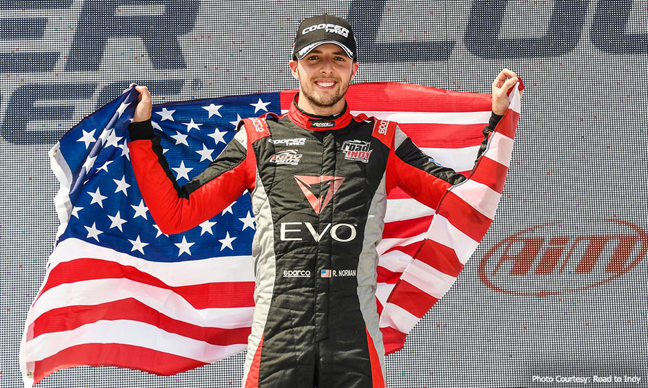Ryan Norman with U.S. flag at Road America