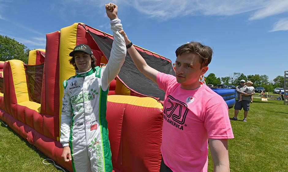 Colton Herta and George Steinbrenner IV at Road America family fun zone