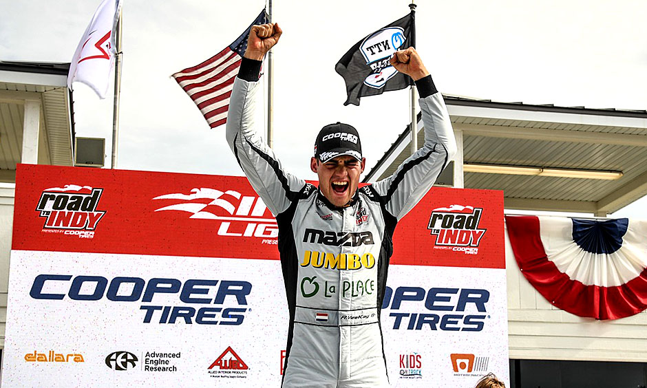 Rinus Veekay celebrates a win at Road America