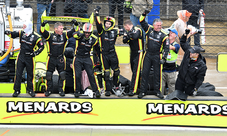 Simon Pagenaud's crew celebrates his 2019 win in the INDYCAR Grand Prix.