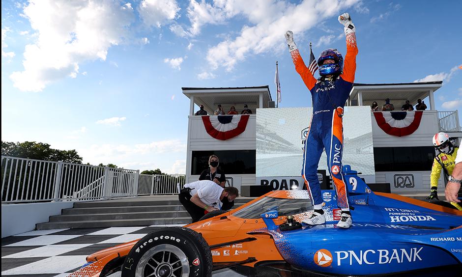 Scott Dixon celebrates his Road America win