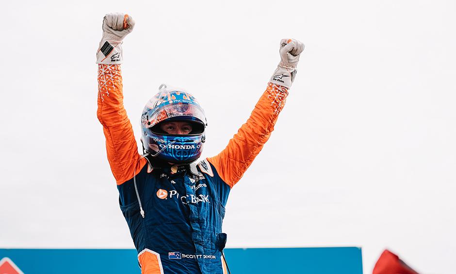 Scott Dixon celebrates his win
