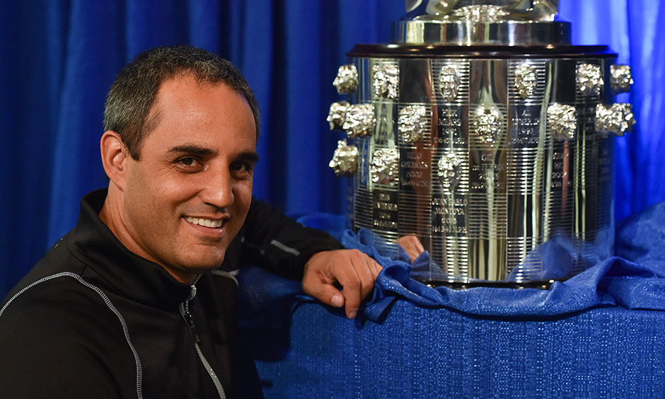 Juan Pablo Montoya with his likeness on the Borg-Warner Trophy