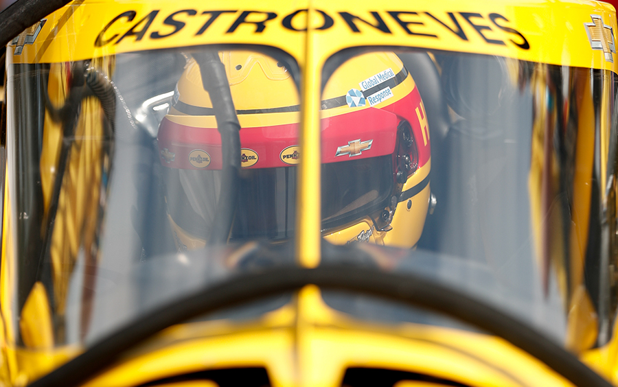Helio Castroneves in his car at Indianapolis