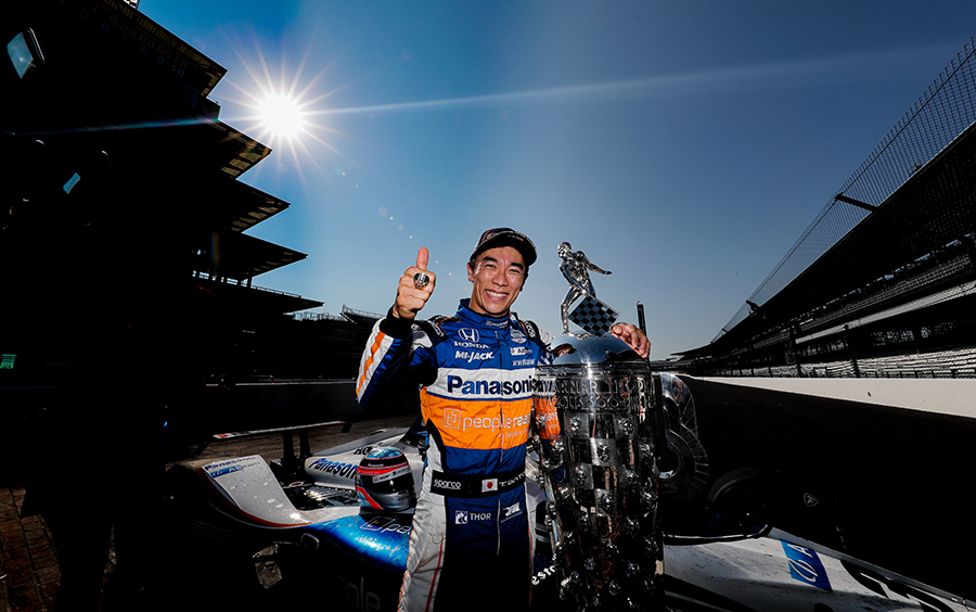 Takuma Sato with the Borg-Warner Trophy after winning the Indy 500.