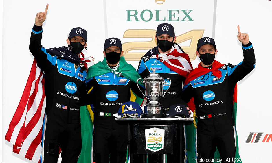 Alexander Rossi and Helio Castroneves with their Wayne Taylor Racing teammates.