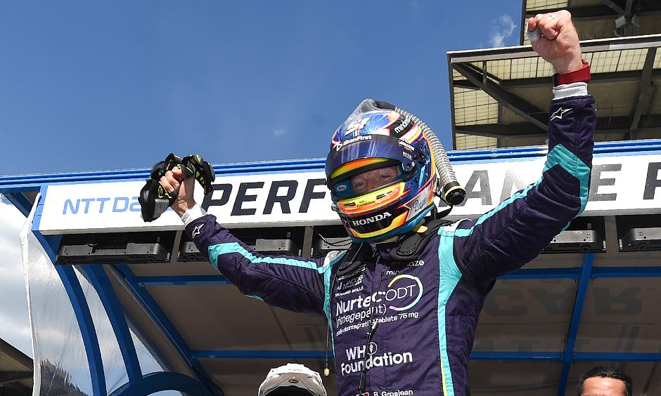 Romain Grosjean wins the NTT P1 Award.