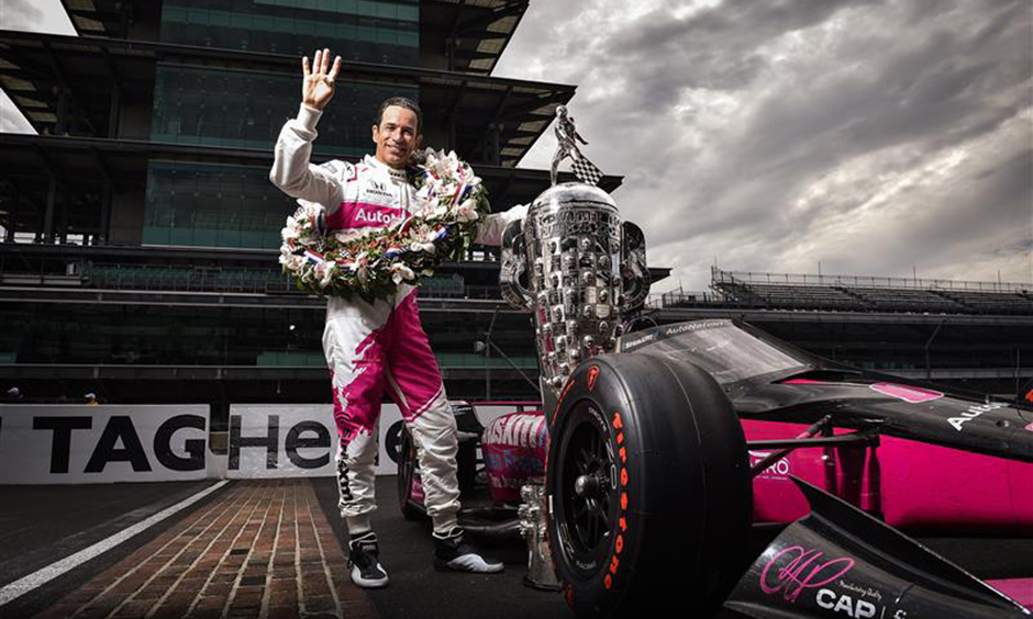 Helio Castroneves at the traditional winner's photo shoot