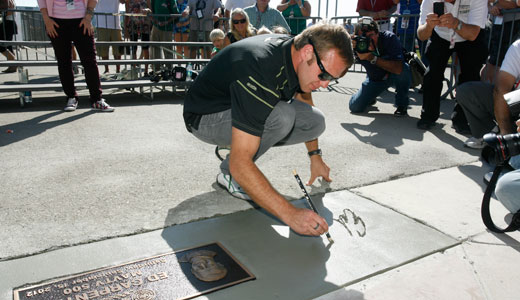Ed Carpenter signs his name at Auto Club Speedway