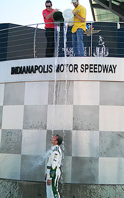 Ed Carpenter accepts the ice bucket challenge with the help of James Hinchcliffe