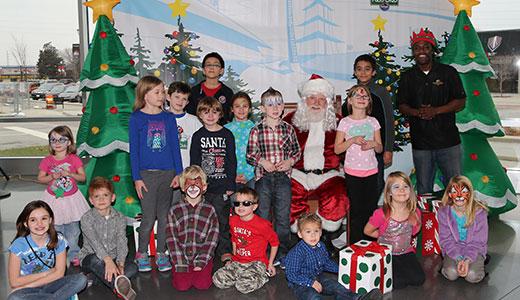 Kids visit Santa Claus at Dallara Factory