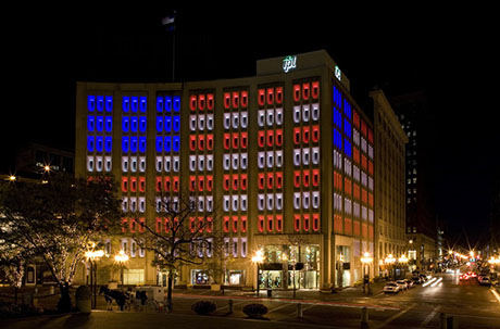 The IPL Building is lit up like the American flag