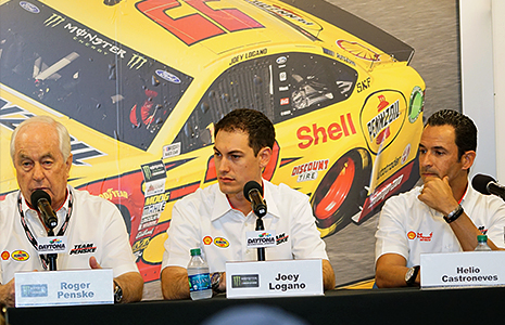 Roger Penske, Joey Logano, and Helio Castroneves