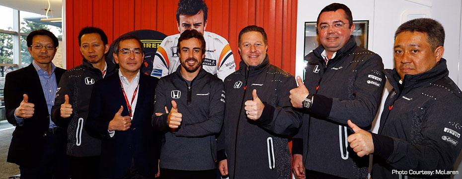 Fernando Alonso, Zak Brown, and McLaren