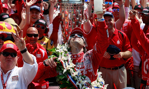 Dario Salutes Wheldon With Milk
