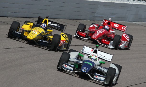 Simona De Silvestro leads Dario Franchitti and Scott Dixon during practice