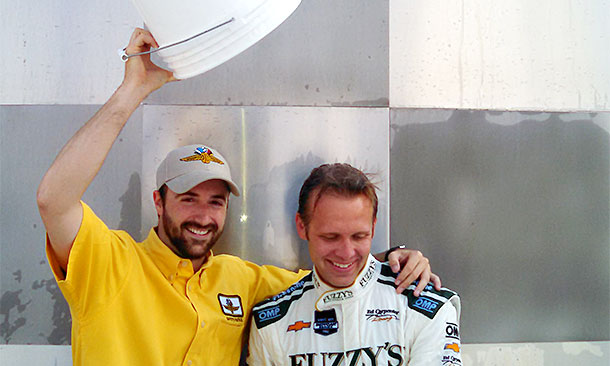 With an assist from James Hinchcliffe, left, Ed Carpenter accepted the ALS Ice Bucket Challlenge.