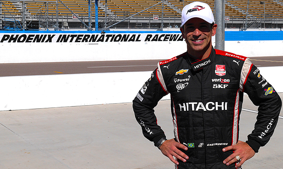 Helio Castroneves stands on pit lane at Phoenix International Raceway