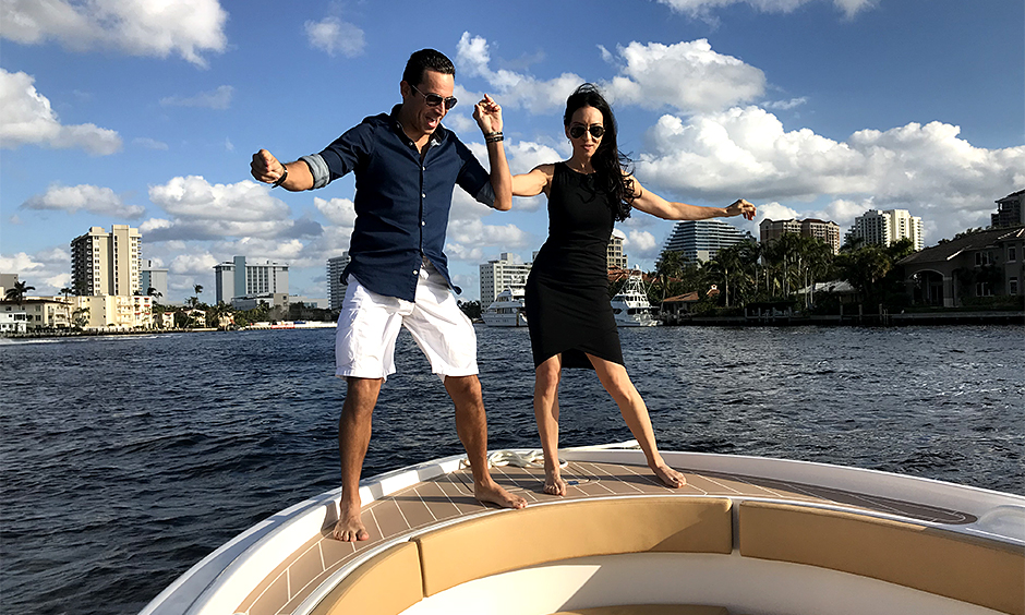 Helio Castroneves dancing on a both with Young Hollywood anchor Leslie Robbins.