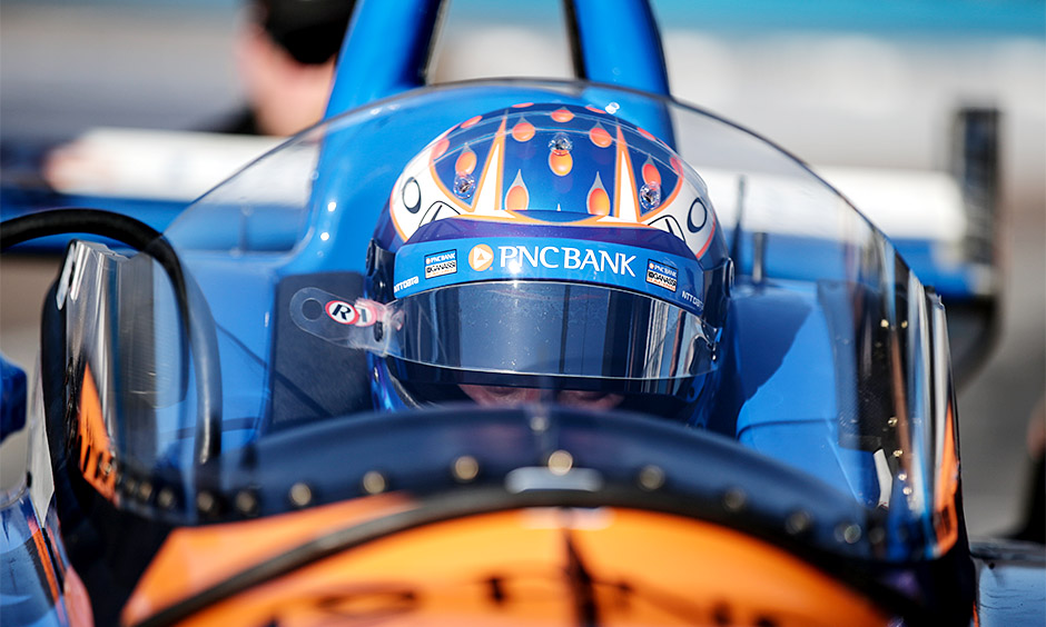 Scott Dixon sits in his No. 9 PNC Chip Ganassi Racing Indy car, which is outfitted with a prototype windscreen.